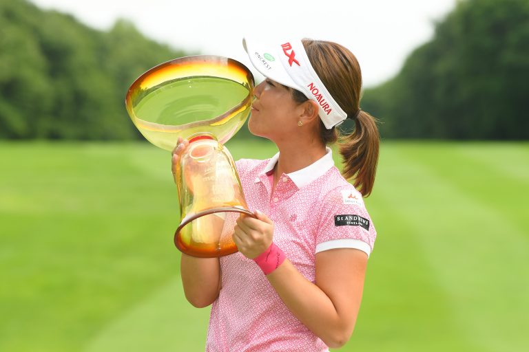 KITAHIROSHIMA, JAPAN - AUGUST 05:  Mami Fukuda of Japan poses with the trophy after winning the Hokkaido meiji Cup at the Sapporo International Country Club Shimamatu Course on August 5, 2018 in Kitahiroshima, Hokkaido, Japan.  (Photo by Atsushi Tomura/Getty Images)
